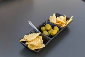 Olives and potato chips as a snack in Rome
