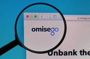 OmiseGO logo under magnifying glass