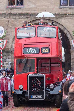 One of the most known and successful music bands from Cologne, Bläck Fööss, celebrates its 50th anniversary by parading on board a double-decker bus on Rose Monday in Cologne