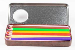 Open iron box with colored pencils (Flip 2020)