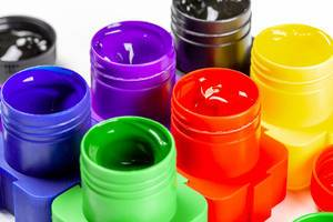Open jars of paint for drawing, close-up