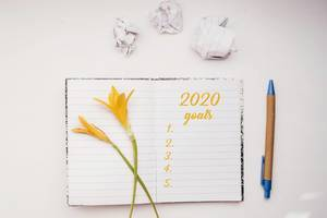 Open Notebook with 2020 Goals list written in yellow