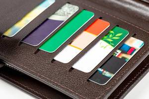 Open wallet with plastic cards, close -up