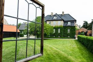 Open window looking out to a green grass field and elegant Danish house (Flip 2019)