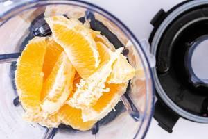Orange fruit sliced in the juice mixer (Flip 2019)
