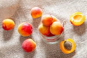 Orange ripe apricots on burlap background (Flip 2019)