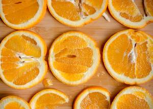 Orange Slices on Wood Board