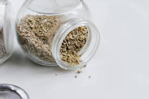 Oregano in a small glass jar