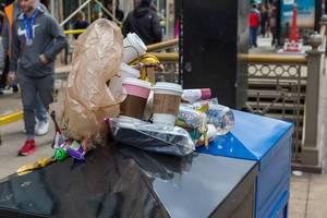 Overflowing litter bins after the 2019 Chicago Marathon