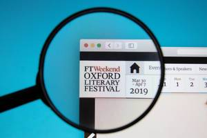 Oxford Literary Festival website on a computer screen with a magnifying glass