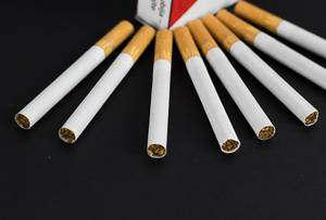Pack of cigarettes on black background