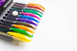 Pack of neon colored pens on white background