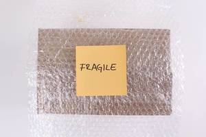 Package in bubble wrap with Fragile text