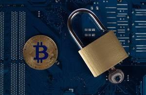 Padlock with golden Bitcoin