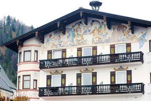 Painted house in Reit im Winkl, Germany. House with balconies