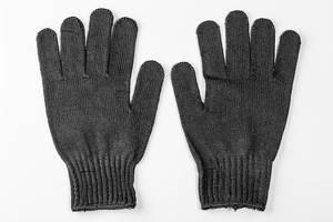 Pair of black work gloves on white background