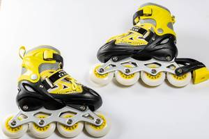 Pair of roller skates on white