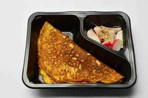 Pancake with radish and sprouts