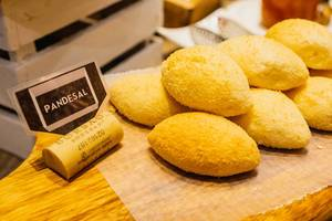 Pandesal bread on wooden tray