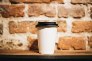 Paper coffee cup on brick wall background  Flip 2019