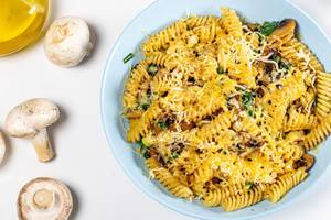 Pasta with mushrooms, cheese and spinach. View from above