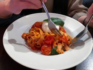 Pasta with tomato sauce, cherry tomatoes, fresh burrata and basil