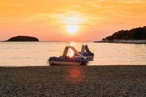 Pedal boats at sunset
