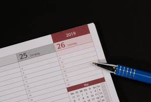 Pen pointing the empty space on the calendar