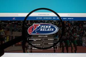 Penn Relays logo on a computer screen with a magnifying glass