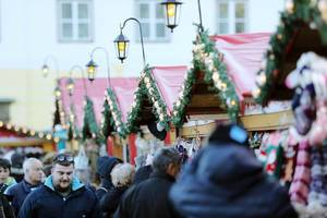 People and huts at Sibiu Christmas Fair