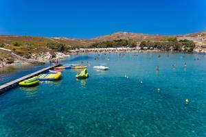 People during summer vacation swimming in the Mediterranean Sea, in front of Monastiri Beach of Korakas, on the Greek island of Paros