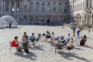 People enjoying a sunny day at Somerset House