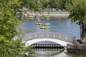 People on paddleboats at Golitsynskiye Prudy in Gorky Park