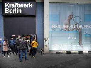 People rushing toward the entrance of photography event – Berlin Photo Week