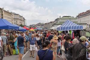 People shopping at the Naschmark flea market in Vienna