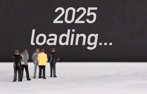 People standing in front of 2025 loading text