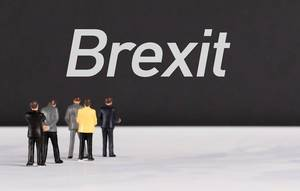People standing in front of Brexit text