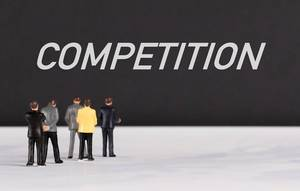 People standing in front of Competition text