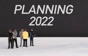 People standing in front of Planning 2022 text