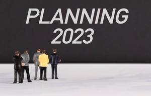 People standing in front of Planning 2023 text