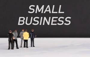 People standing in front of Small Business text