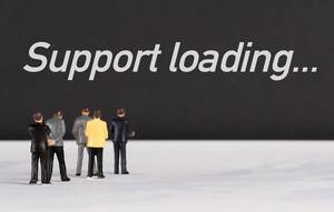 People standing in front of Support loading text