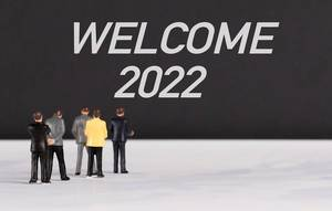 People standing in front of Welcome 2022 text