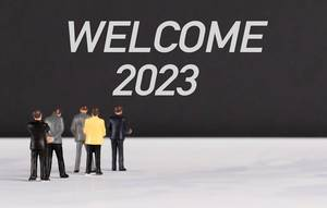 People standing in front of Welcome 2023 text