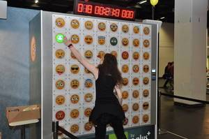 Person doing a reaction test on a wall with emojis and a timer