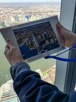 Person Holding a Augmented Reality Tour Screen at Observatory of One World Trade Center