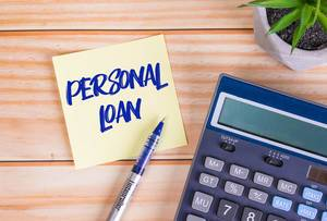 Personal loan text on a sticky note