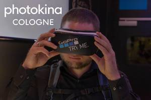"Photo fair visitor tests the VR glasses by GoPro, next to the picture title ""photokina Cologne"""