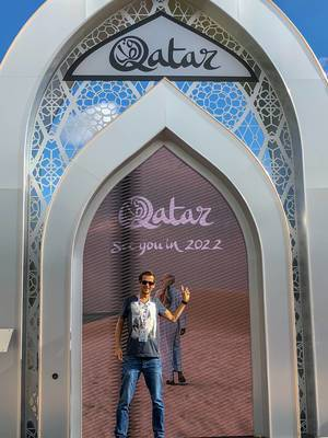 Photo in front of a signboard of Qatar 2022 FIFA World Cup