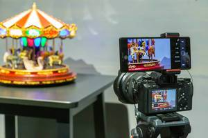 Picture quality and colour comparison: smartphone camera and photo camera take a picture of a vintage carousel music box